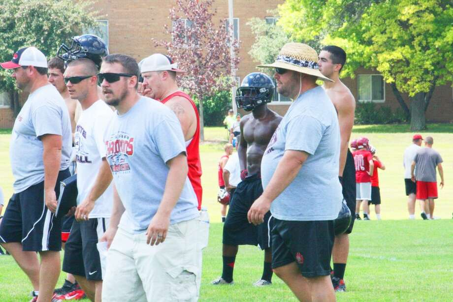 Pass tournament: Monty Price (right) and his Reed City football staff watch the action on Saturday at the Ferris 7-on-7 tournament. (Herald Review/John Raffel)