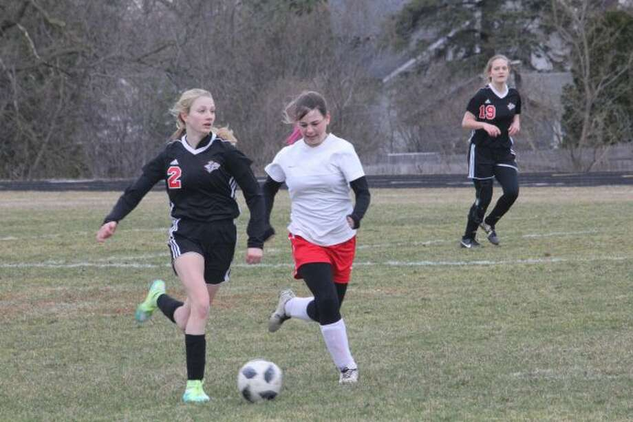 Karlie Kearns takes care of the ball against Kent City.
