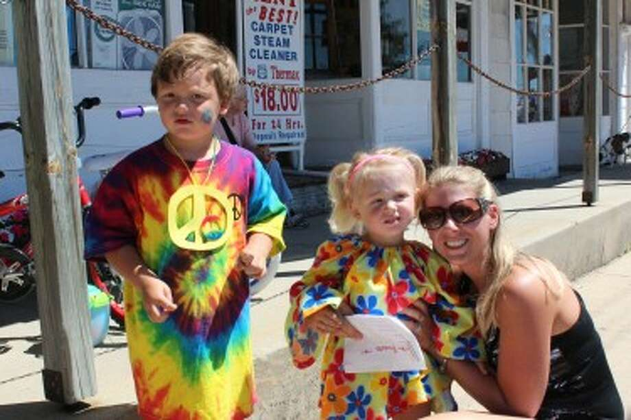 Hunter Shelton, 4, and Morgan Wanstead, 2, were chosen on Friday as the LeRoy prince and princess during Razzasque Days, which took place through Saturday in the village. Wanstead's proud mother, Melissa, joined in the photo. (Herald Review photo/Karin Armbruster)