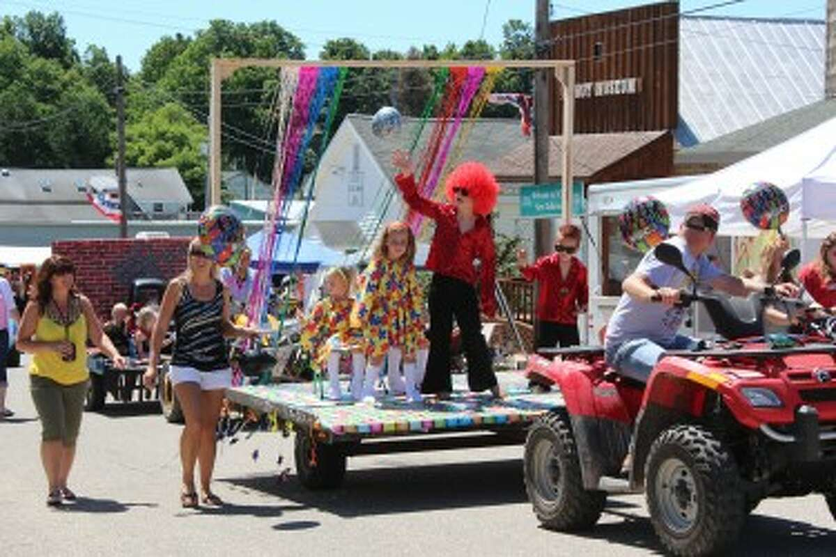 Children of all ages participate in the Razzasque Days kid's parade that traveled through the downtown LeRoy. (Herald Review photo/Karin Armbruster)