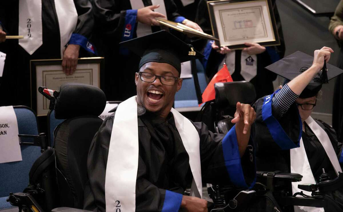 A graduate reacts with joy at receiving his certificate from the UHD-HEART Program on Friday, Aug. 16, at the University of Houston Downtown. The three-semester program is designed to give adults with intellectual and/or developmental disabilities better educational, life and job opportunities.