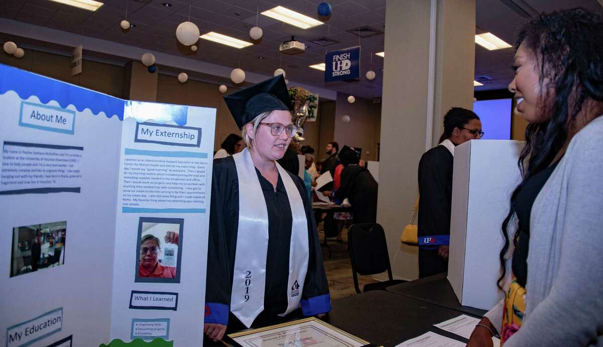 At her graduation from the UHD-HEART Program at the University of Houston Downtown on Friday, Aug. 16, graduate Peyton, 22 (center), presents what she has learned in the last three semesters.