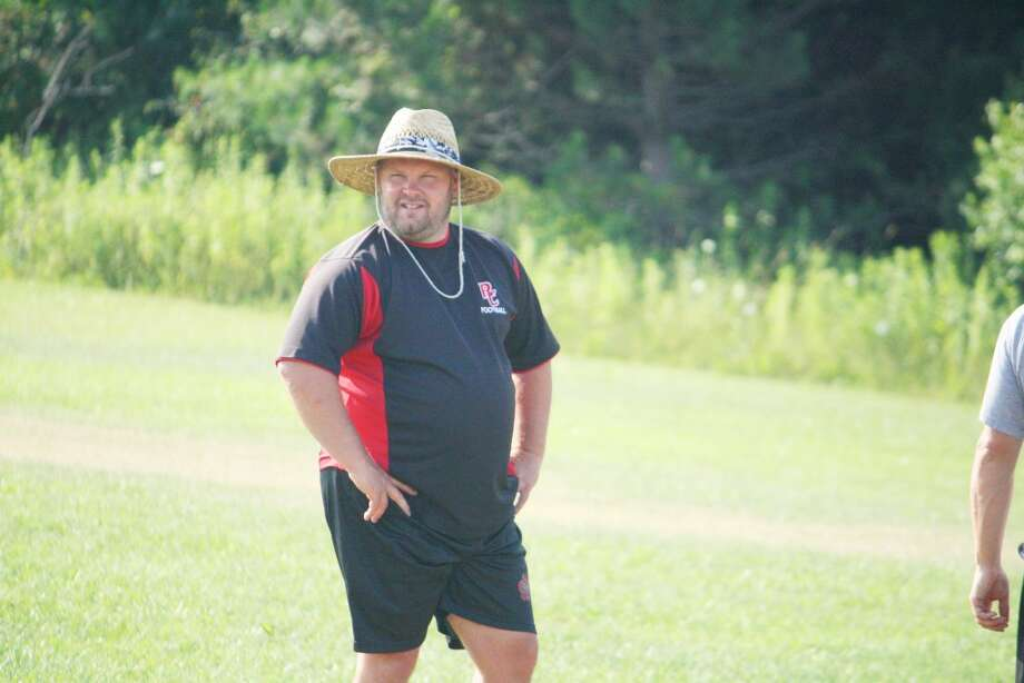 Football coach: New Reed City High School principal Monty Price supervises a football conditioning session Monday. (Herald Review/John Raffel)