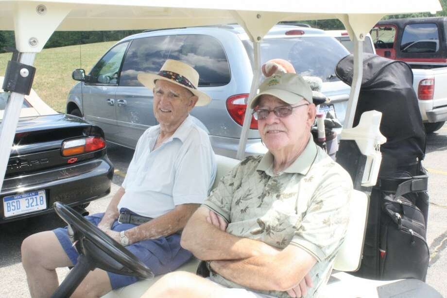 Masters golf: Dale Williams (left) and Dave Steele get ready for a day of Masters Golf League at Spring Valley last week. (Herald Review/Raffel)
