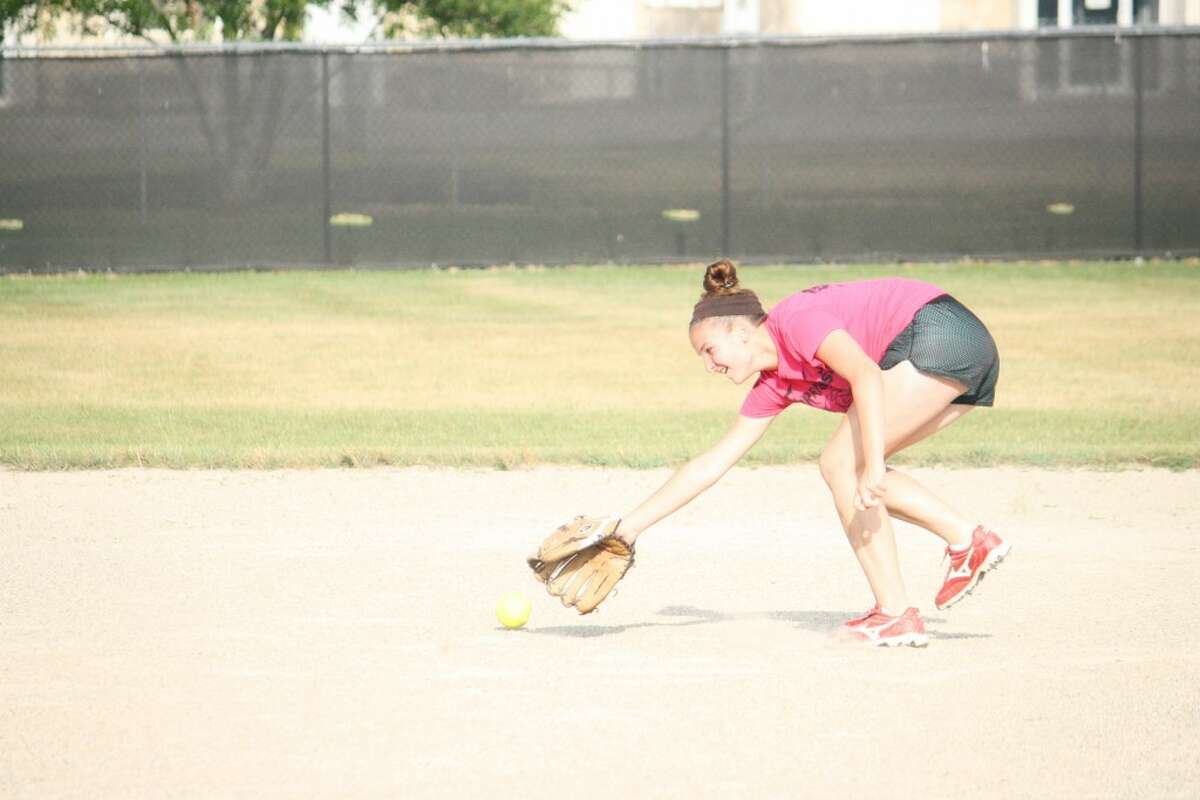 Softball: Olivia Lawson goes after the ball Sunday in a Reed City practice. (Herald Review/John Raffel)