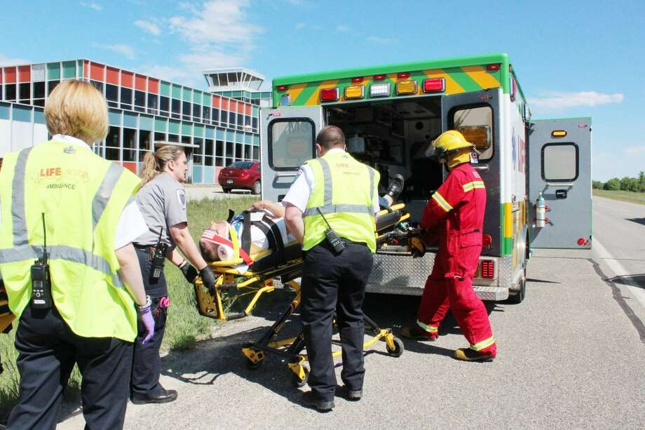EMERGENCY SERVICES: Local EMS personnel recently spent a day refreshing their skills in a mock highway-pileup. Having well trained EMS people and facilities based within reach of residents is crucial to the safety and well being of the community. (File photo)