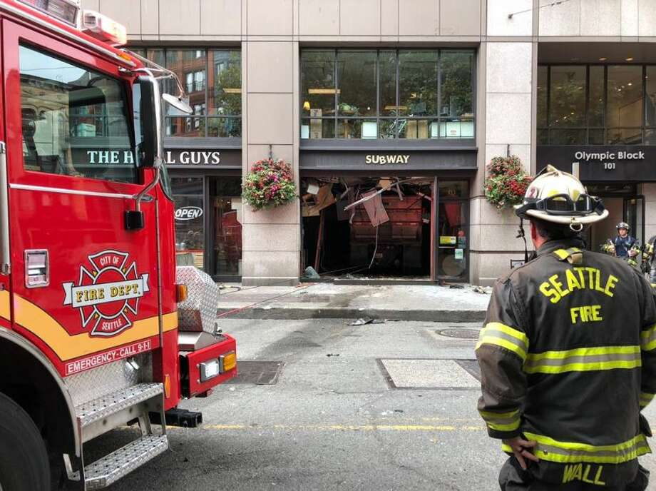 A dump truck crashed into a Subway sandwich shop in Pioneer Square on Monday. Four patients were transported to Harborview Medical Center. Photo: Courtesy Seattle Fire