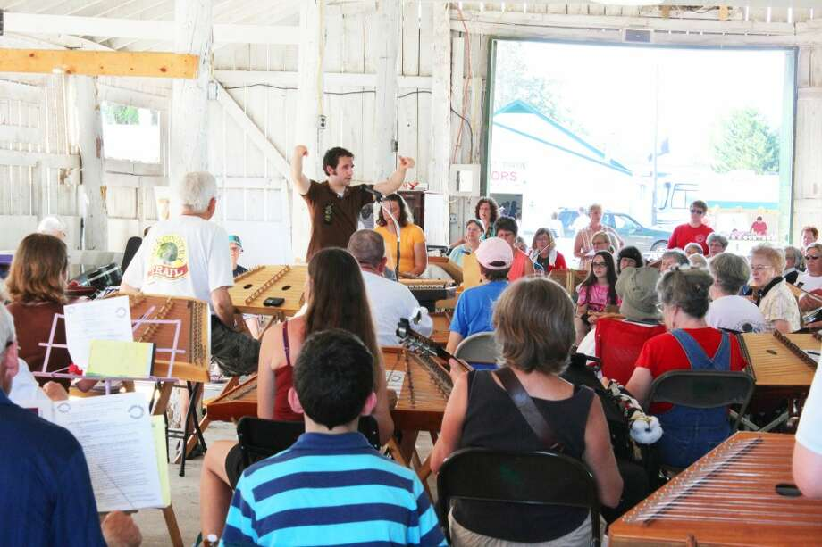 Hammered Dulcimer: (ABOVE) Thousands of people from young to old and from across the world gathered in Evart at the Osceola County 4H-FFA Fairgrounds on Thursday to enjoy the 41st annual Dulcimer Funfest.
