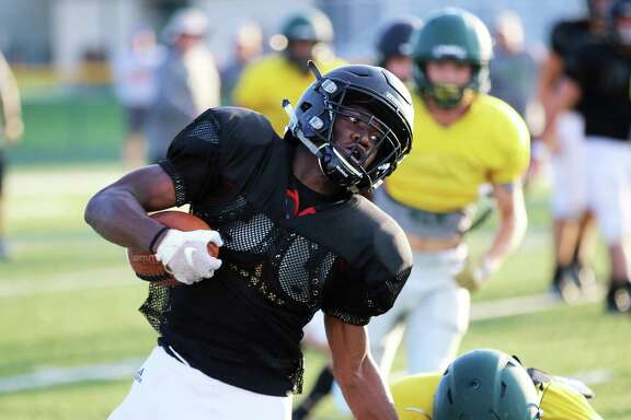 Panther senior running back Elishia Chambers rounds the corner for a gain in the scrimmage against No. 10 state-ranked East Chambers last Friday.