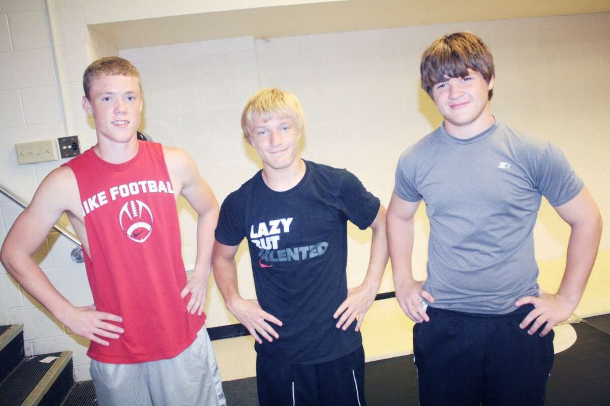 wrestlers: From left, Devyn Ward, Thayne Stieg and Dylan Chrispell get ready for a summer wrestling workout at Reed City. (Herald Review/John Raffel)