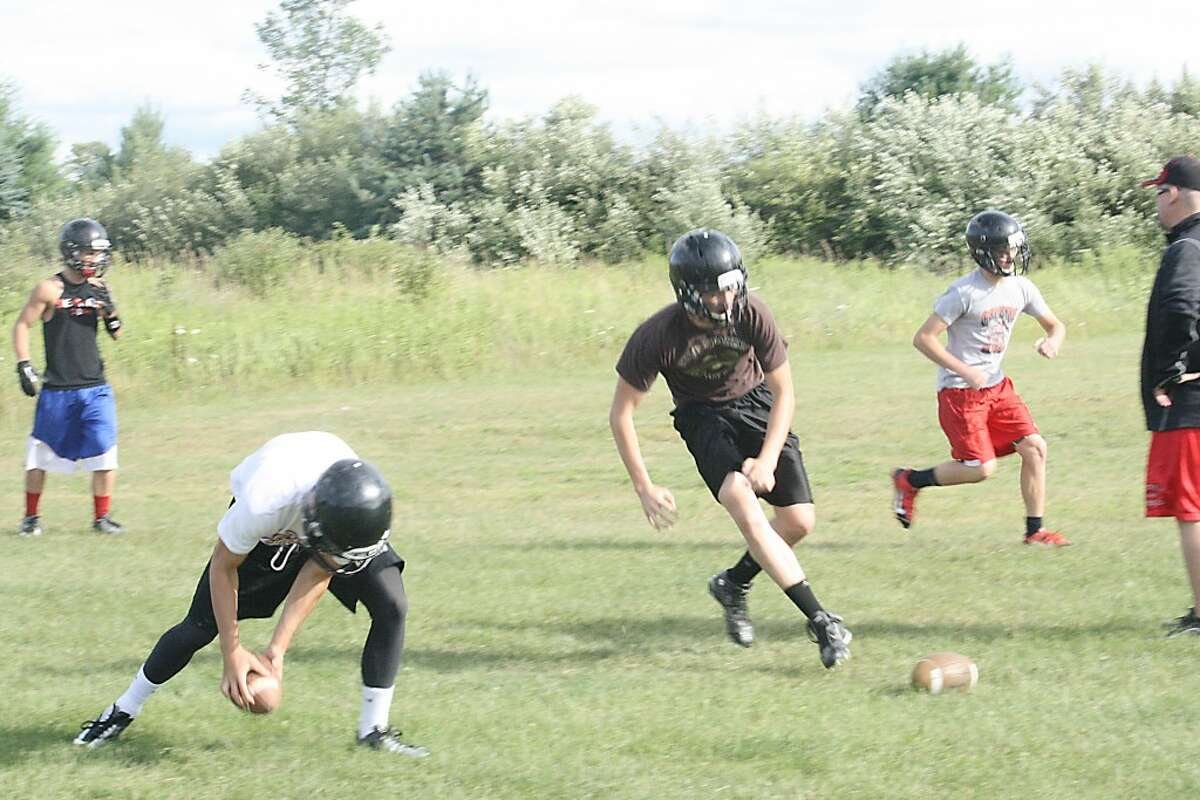 football practice: Reed City football players go after the ball during skills camp this week. (Herald Review/John Raffel)