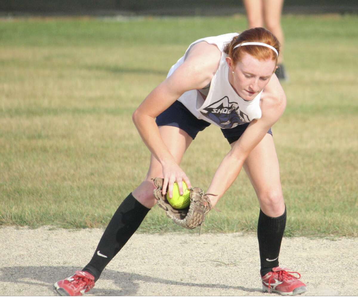 softball: Lindsey Greer of Reed City works on her fielding during a practice. (Herald Review/John Raffel)