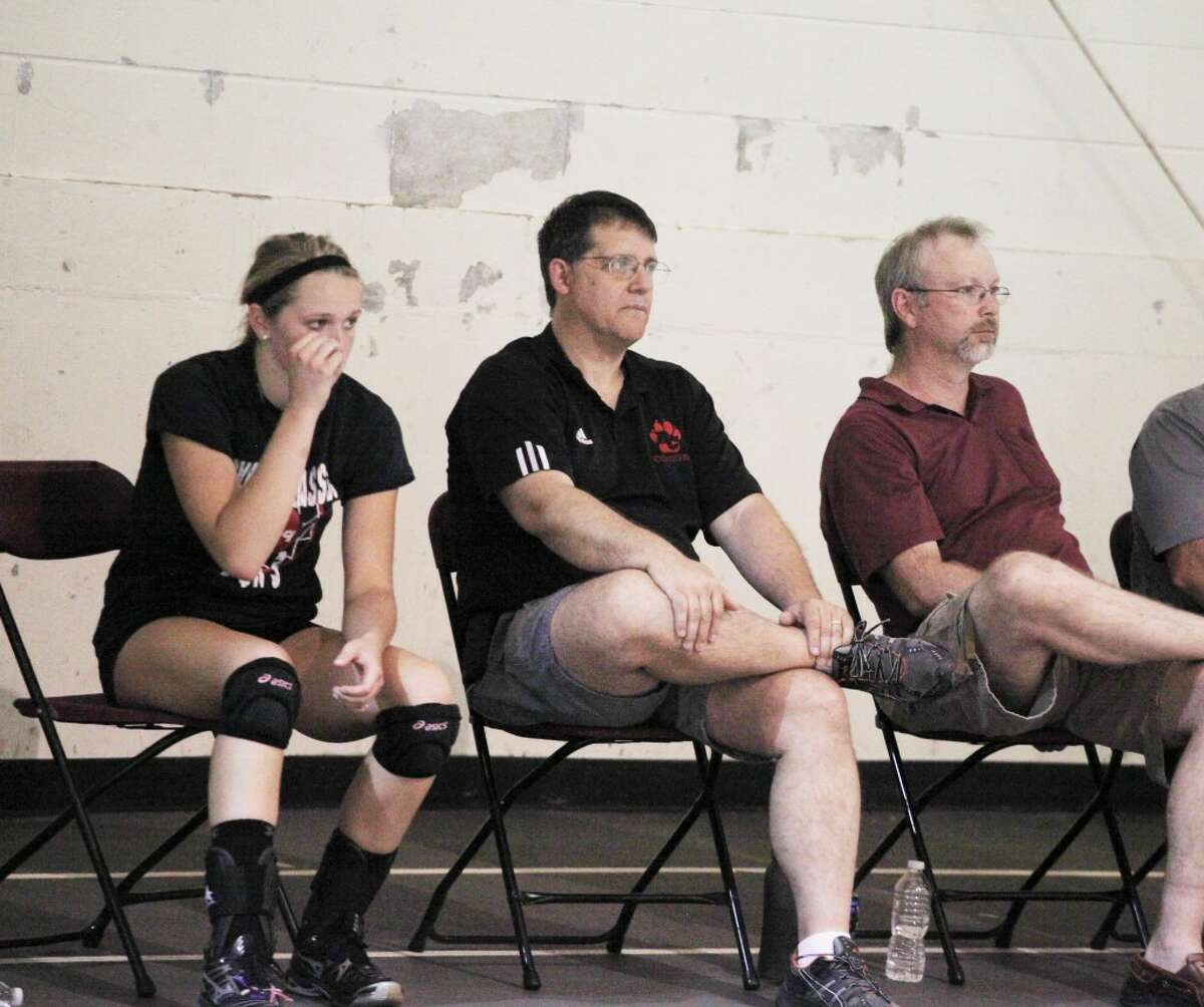 volleyball: Reed City volleyball coach Don Patterson (center) watches the action during last week's Ferris State camp. (Herald Review/Martin Slagter).