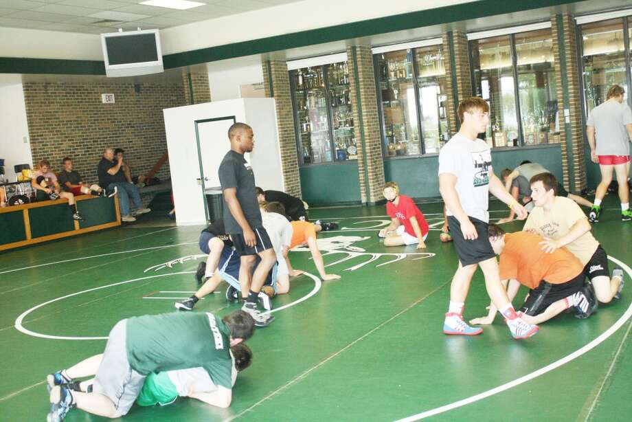 Wrestling camp: Michigan State wrestlers supervise the action last week during the Pine River Summer Camp. (Herald Review/John Raffel)