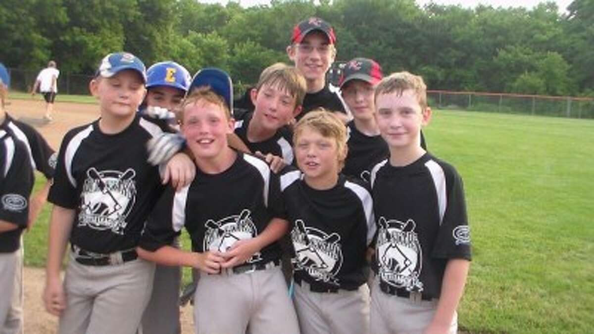 Birthday: Reed City-Evart Major Division All-Stars celebrate a tournament win. (File photo)