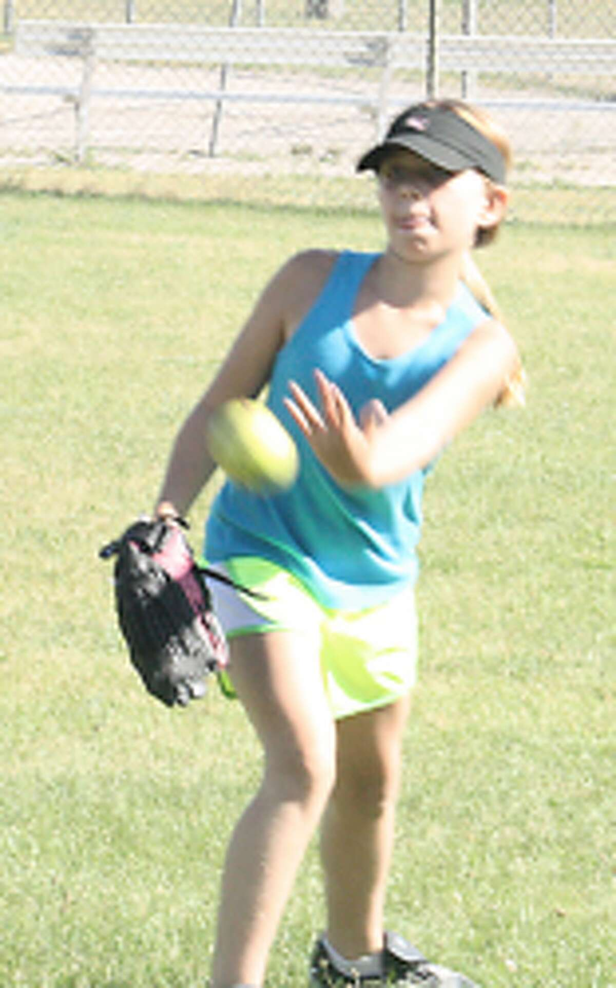 Softball: Josie Hoppes of Reed City-Evart works on her pitching during a practice last week. (Herald Review/John Raffel)