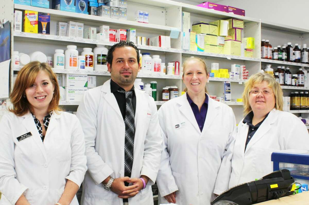 Excellent staff: CET Pharmacy staff members (from left) Mia Miles, Dr. Mike Basma, Beth Sweney and Jodi Sayer make sure to create personal relationships with customers while providing fast service. The pharmacy is located at 204 N. Patterson Road next to Spectrum Health Reed City Hospital. (Herald Review photo/Karin Armbruster)
