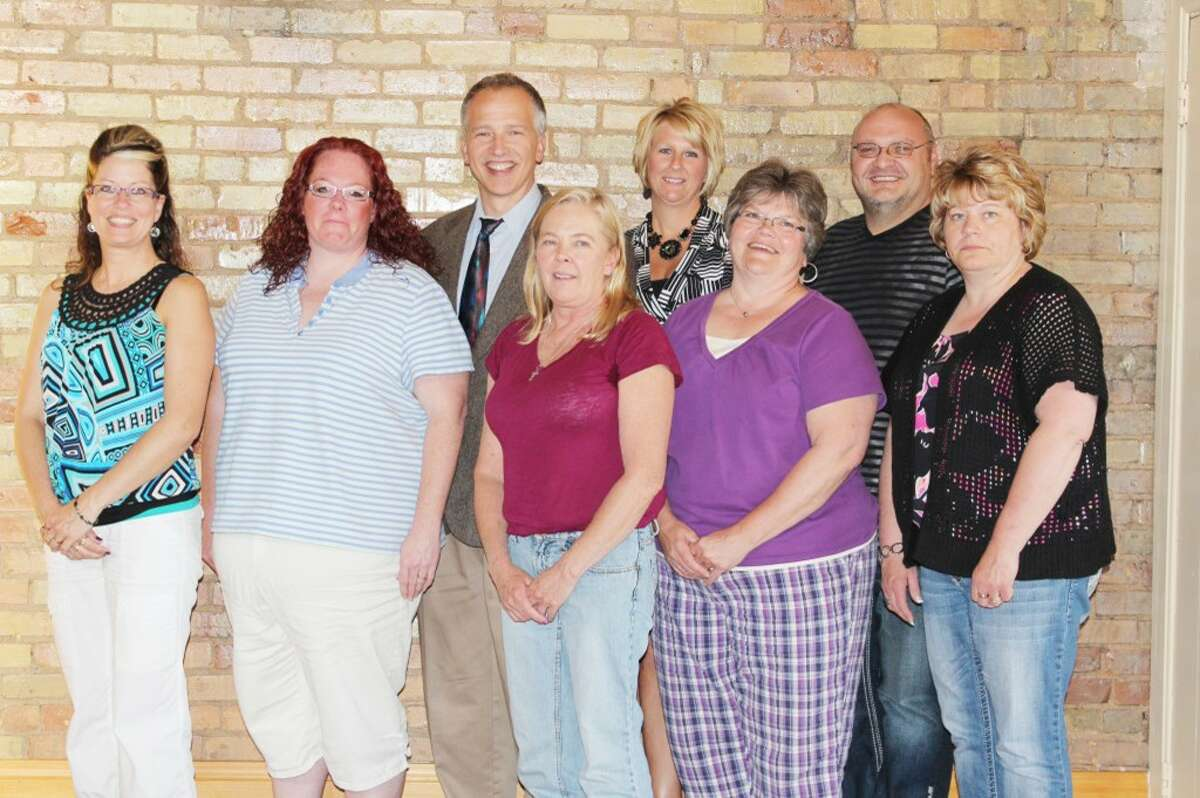Leadership: Members of the 2012-13 Osceola Leadership Summit, including (TOP ROW) Al Weinberg, Carey Johnson, Eric Schmidt, (BOTTOM ROW) Karen Copeman, Stacie Dvonch, Robbie Forman, Rosie McKinstry and Jill Halladay pose for a photo after receiving their awards during a graduation ceremony that took place in May. (Herald Review file photo)
