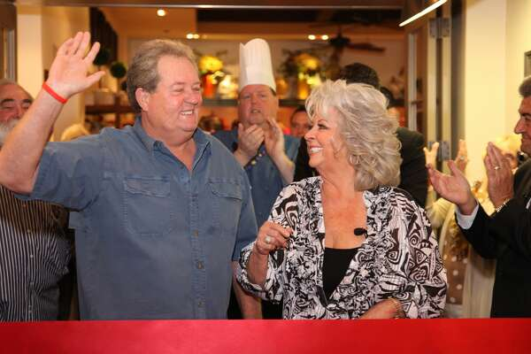 Paula Deen and her brother Bubba Hiers attend Paula Deen's Kitchen grand opening at Chicago Harrah's Joliet Casino & Hotel on April 5, 2012 in Chicago, Illinois. (Photo by Michael Roman/WireImage)