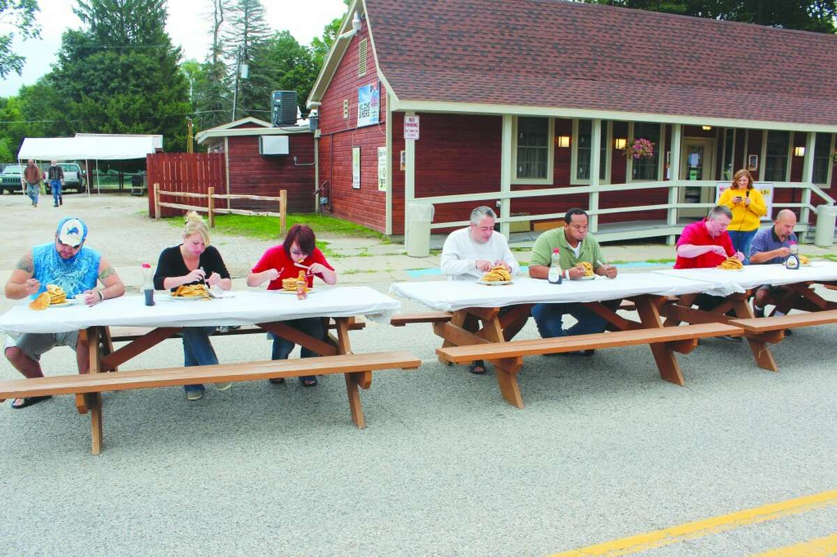 Pancake eating: Brave attendees of last year's Hersey River Town Festival try to eat as many pancakes as possible in a three-minute period. This year, the event will take place at 9 a.m. on Saturday. The River Town Festival takes place Thursday through Saturday. (Herald Review photo)