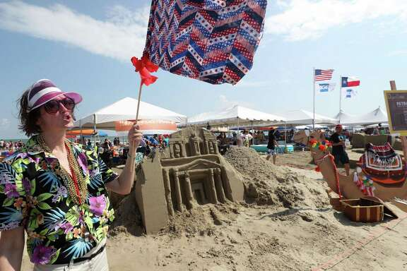 Nicole Jordan with Harris & Kornberg Architects talks about their sandcastle portraying Petra, a historical and archaeological city in southern Jordan, during the 32nd Annual AIA Sandcastle Competition at East Beach in Galveston on Saturday, Aug. 25, 2018.