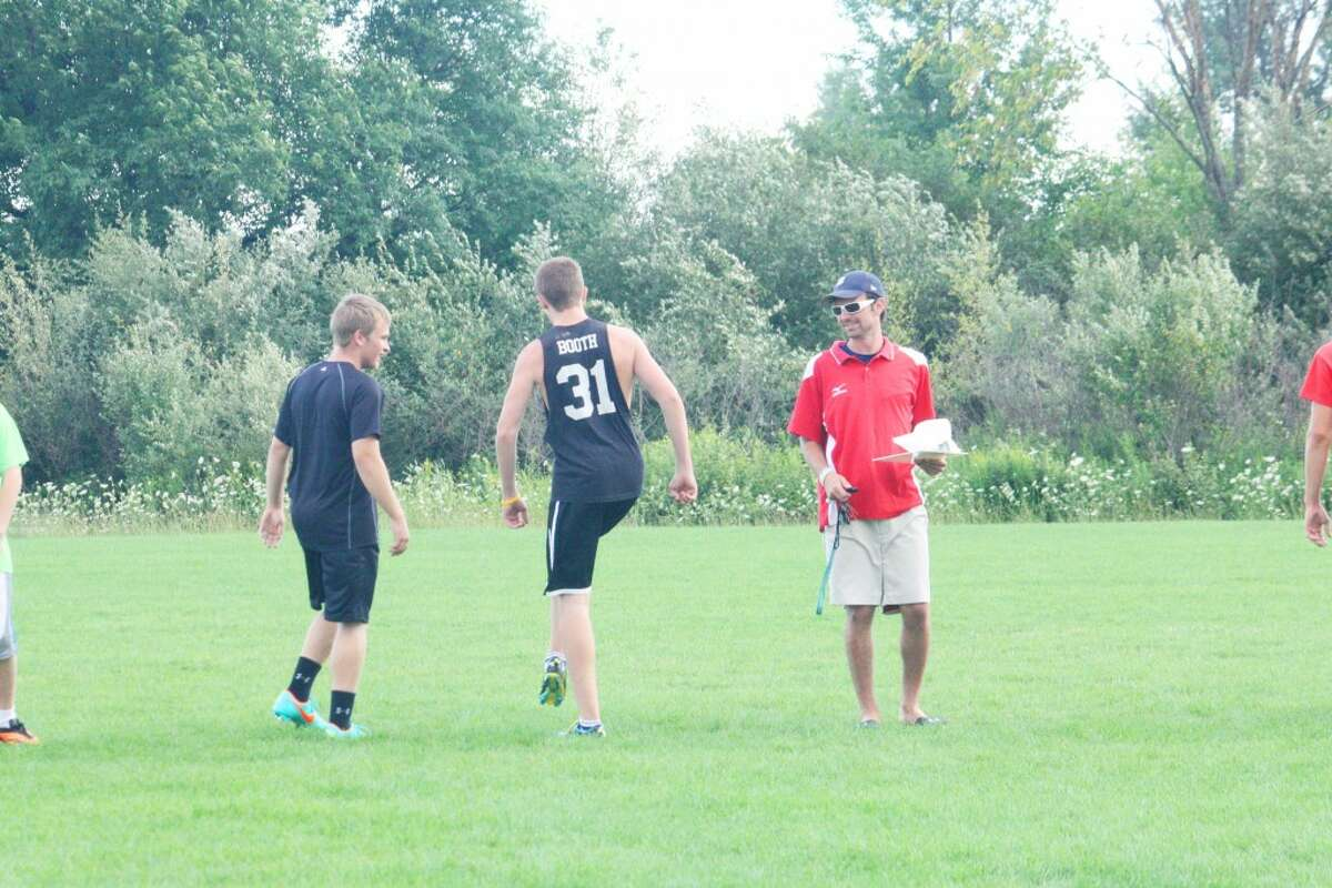Soccer Practice: Reed City soccer players work on conditioning drills Monday night. (Herald Review/John Raffel)