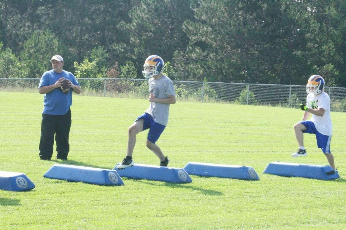 Practice: Evart football players work on a drill Monday. (Herald Review/John Raffel)