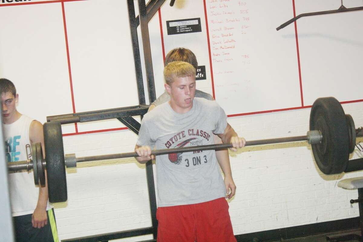 lifting: Reed City football players were busy in the weight room last Thursday. (Herald Review/John Raffel)