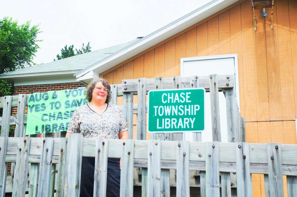 VOTED DOWN: Chase Township Public Library Director Roxanne Ware stands outside of the library on Tuesday, election day. The .25-mil proposed millage to fund library operations was defeated, but Ware says she is optimistic that the library will continue to stay open with the support of the community. (Herald Review photo/Kyle Leppek)