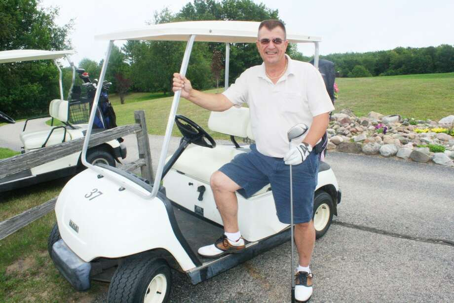 Gary Bailey gets ready for a round of golf at Spring Valley. (Herald Review/John Raffel)