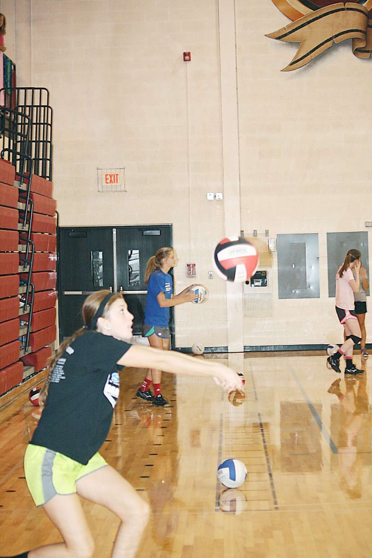 PRACTICE: Alaina Woodard works on her passing during a Monday Reed City volleyball practice. (Herald Review/John Raffel)