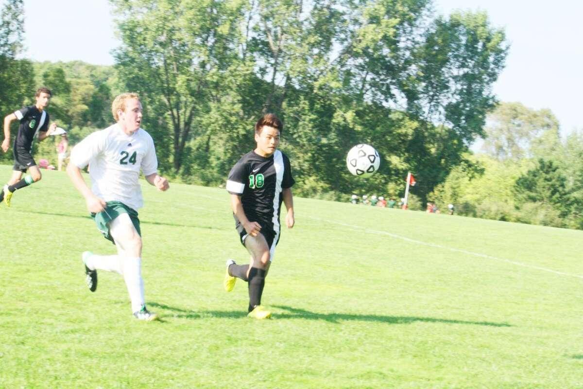 Luke Harris (24) of Pine River goes after the ball against Houghton Lake. (Herald Review/John Raffel)