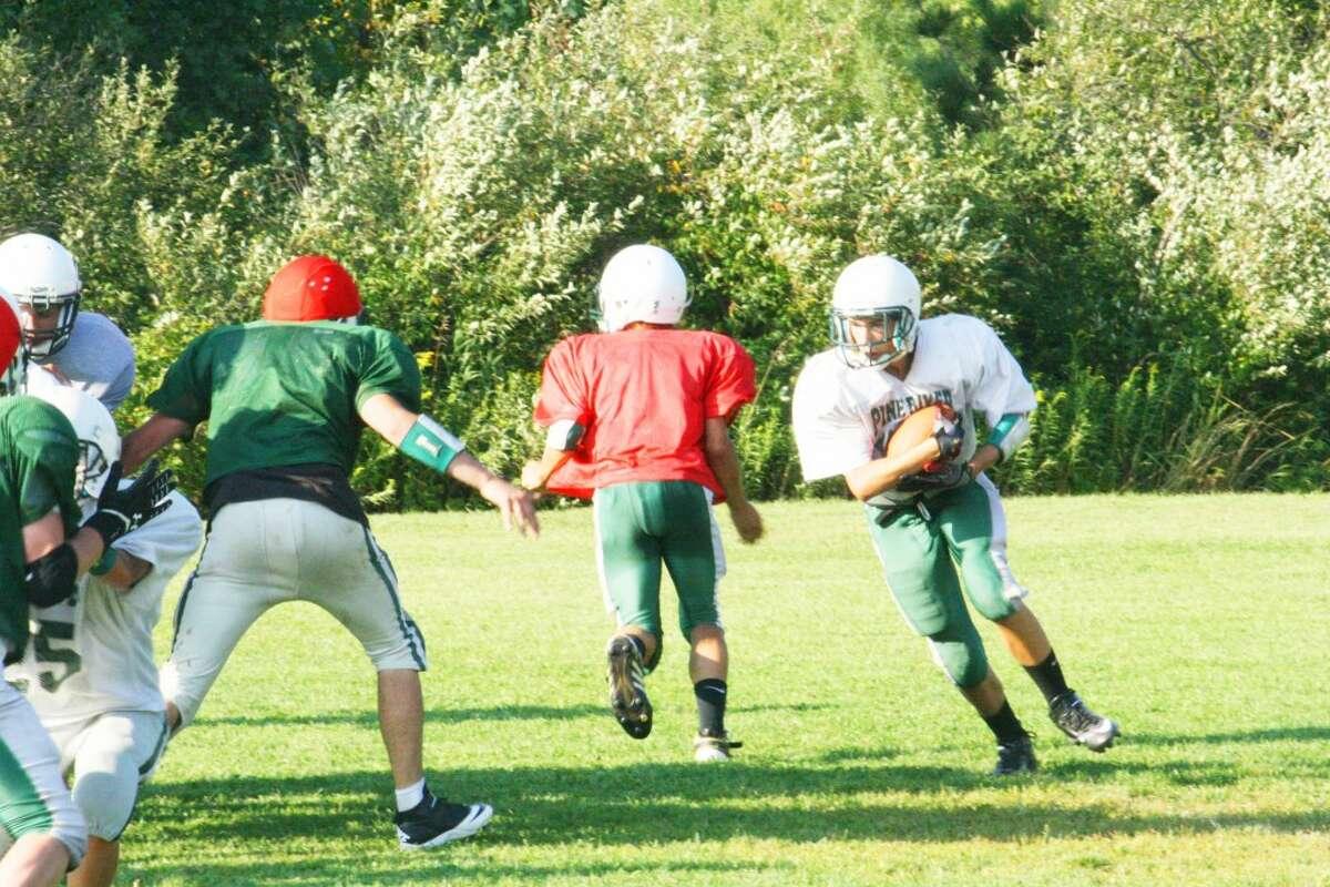 OPENER: Pine River football players work on a running play Monday. (Herald Review/John Raffel)