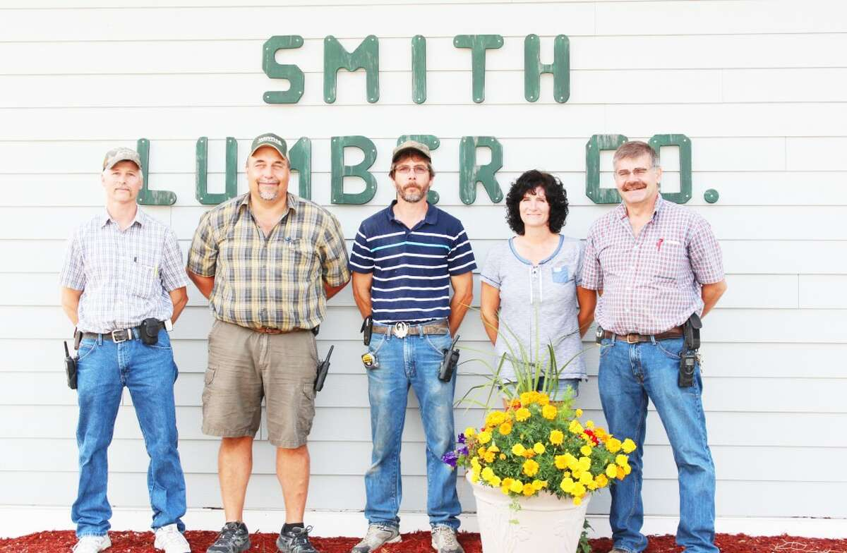 A long history: Smith Lumber Co. in Evart is a business that has a history of more than 100 years offering lumber, hardware, tools, cleaning supplies and other products to help customers complete a number of home and property projects. Staff members (from left) Brent Henry, Jeff Storch, Raymond Crawford and owners RaeMarie and Alan Salinas are available to assist with their expertise. (Herald Review photo/Karin Armbruster)