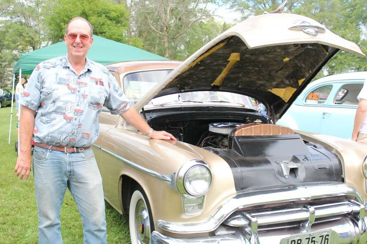 Art Moyses, of LeRoy, poses with his Oldsmobile Rocket 88 at the Evart Car Show, which he purchased three years ago. He said he enjoys attending the car show because of its variety and the chance to meet and talk with new people.