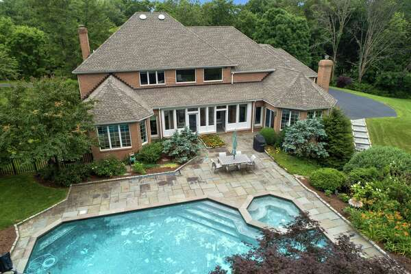 This 3.17-acre level and gently sloping property has a heated Gunite swimming pool with a jetted spa and waterfall, and professional landscaping.
