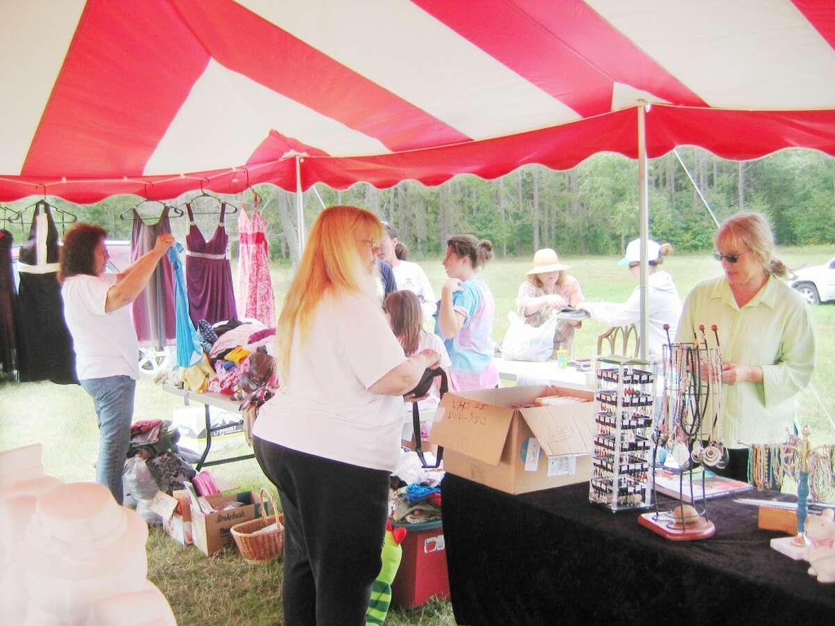 sale: Members of the Osceola League for Arts and Humanities hosted its annual Labor Day yard sale on Saturday and Sunday in Evart.Shoppers enjoyed browsing through practical everyday items and a wide variety of toys, books, games, clothing, linens, craft supplies, jewelry, pottery, furniture, figurines and collectibles. (Herald Review photo/Randy Johnston)