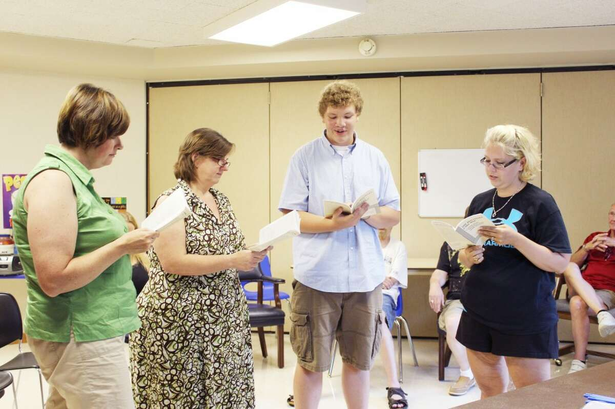 """Crossroads Theatre Guild actors (from left) Melissa Langworthy, Shelly Gerring, Nate Mora and Danielle Kokkonen audition for a part in """"The Red Velvet Cake War,"""" which will be performed in the first and second weekends in November. (Herald Review photo/Karin Armbruster)"""