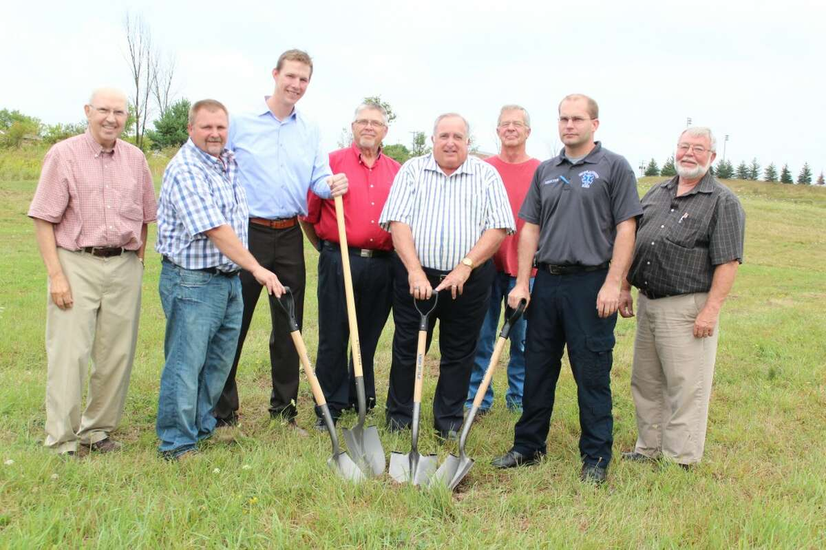 Construction: Area officials, including (from left) commissioner Roger Elkins, project manager Scott Stephens, Rob Gustafson of architecture firm Hooker DeJong, Marion Village President Don Gilmore, commissioner Larry Emig, commissioner Ron Sikkema and commissioner Alan Tiedt. (Herald photo/Karin Armbruster)