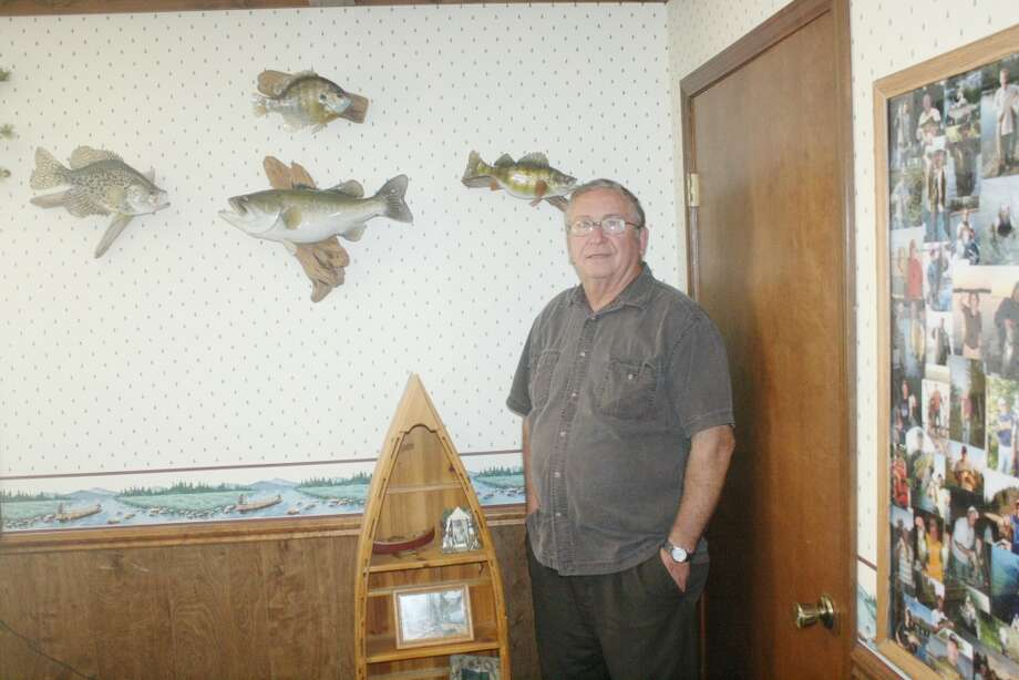Paul Derscheid's love of the outdoors is demonstrated by some of his wall hangings at his Pineview Homes office in Evart. (Herald Review/John Raffel)