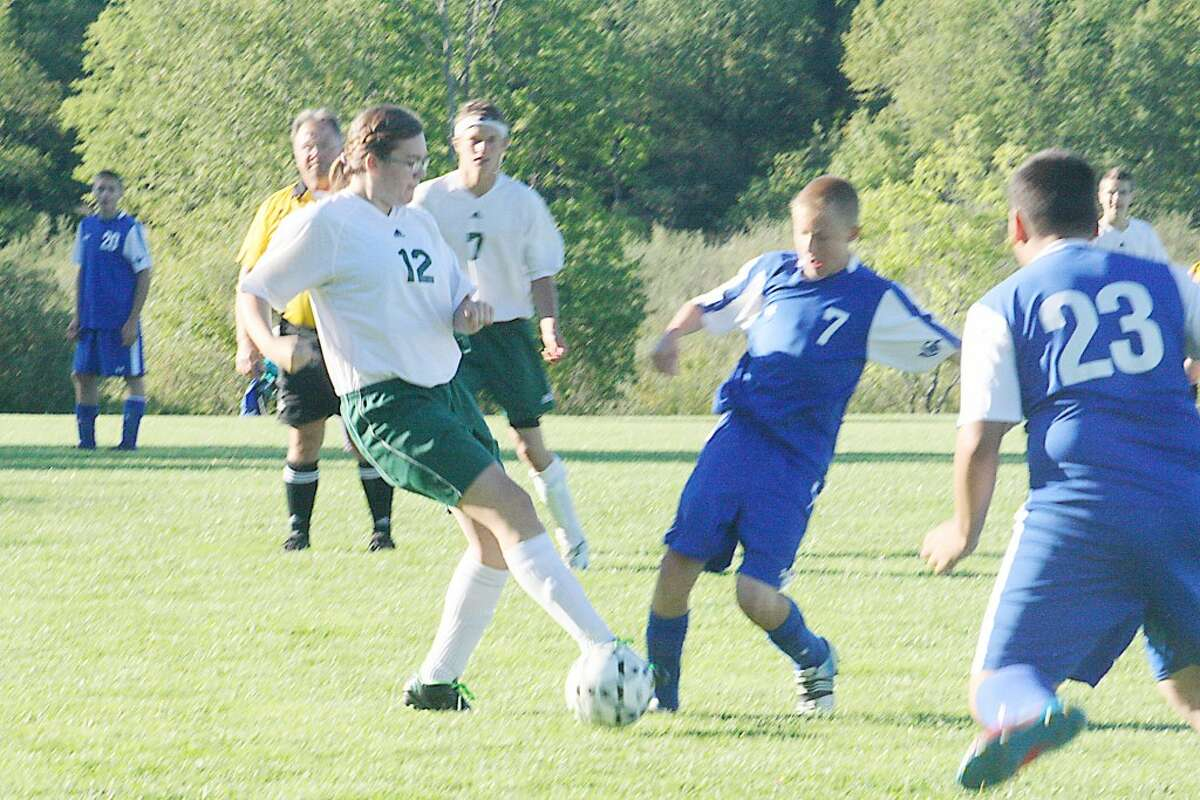 Pine River (left) and Gladwin players go after the ball in soccer action last week. (Herald Review/John Raffel)