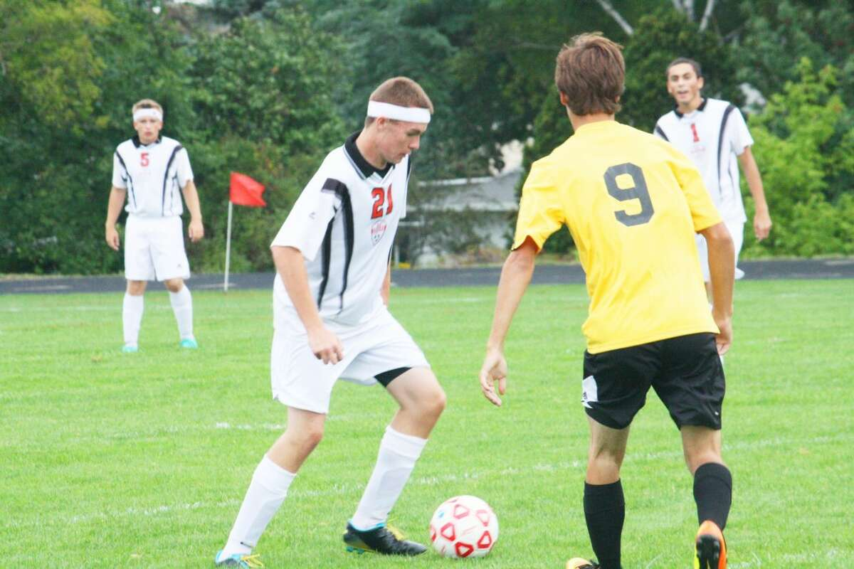 Reed City's Andrew Booth (21) goes after the ball against Tri County last week. (Herald Review/John Raffel)