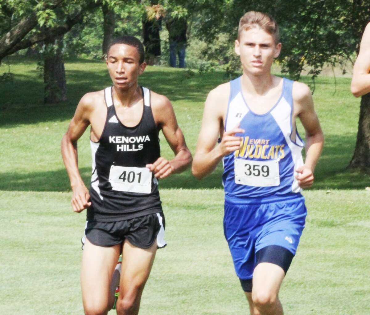 Max Hodges (right) of Evart works his way through the course at Ferris on Saturday. (Herald Review/Martin Slagter)