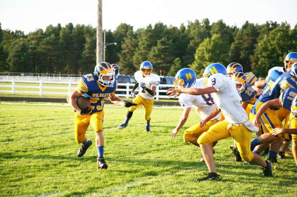 Evart's Dillon Danley (23) looks for running room against Harrison. (Herald Reviewphoto/Bob Allan)