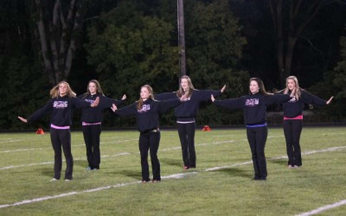 DANCE: Returning Reed City High School Dance Team members (from left) Miranda Battle, Olivia Lawson, Madilyn Allen, Alison Schermerhorn, Tristin Harltey and Natalie Baughan perform at the RCHS football game on Friday. (Herald Review photo/Shannon Hartley)
