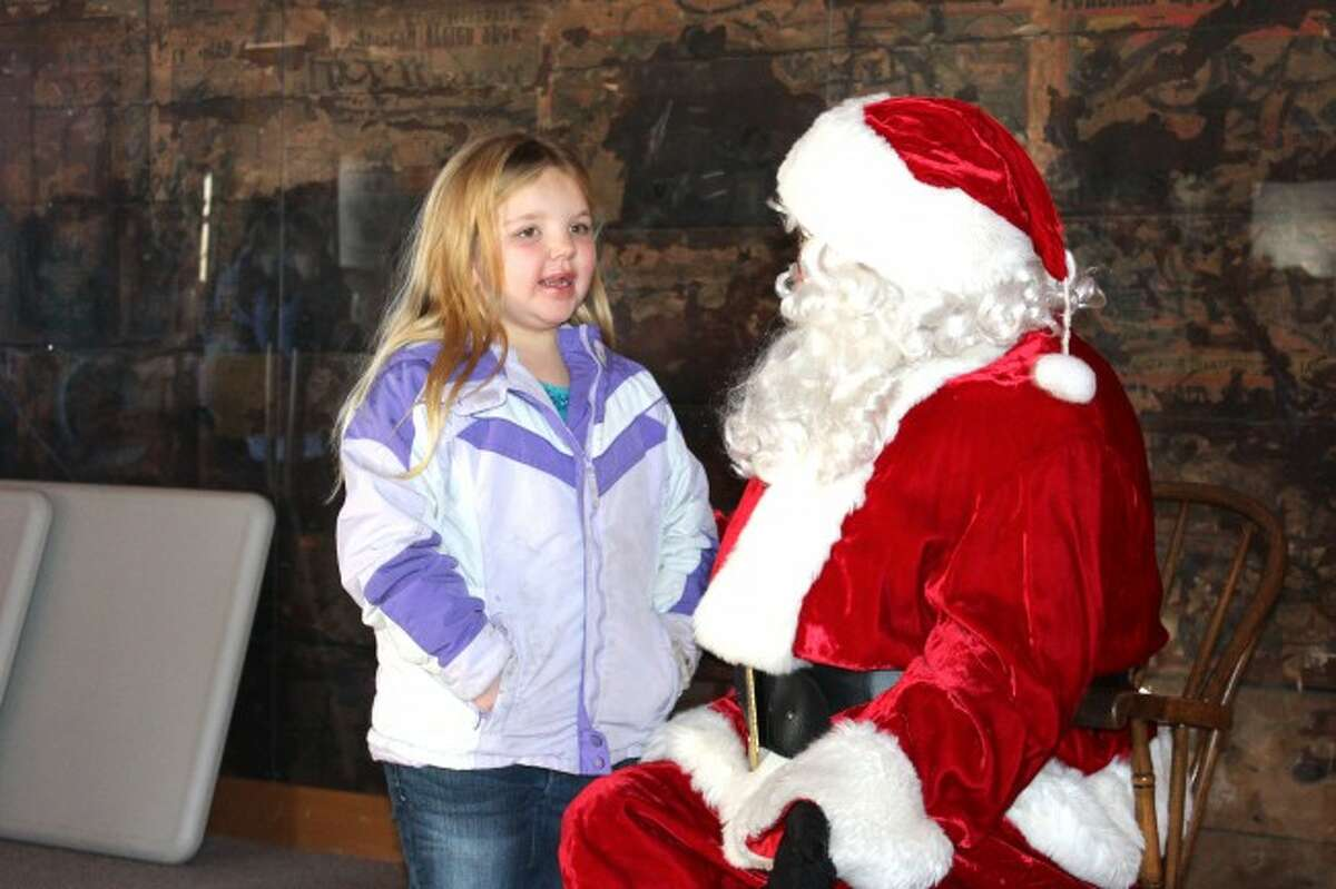 CHRISTMAS TIME: Christmas in a Small town is beginning soon in Evart, with many events fit for the entire family. The popular Christmas Carnival is set for Saturday, Dec. 5, and other activities such as band performances, youth programs and more are scheduled throughout the month of December. (Herald Review file photos)