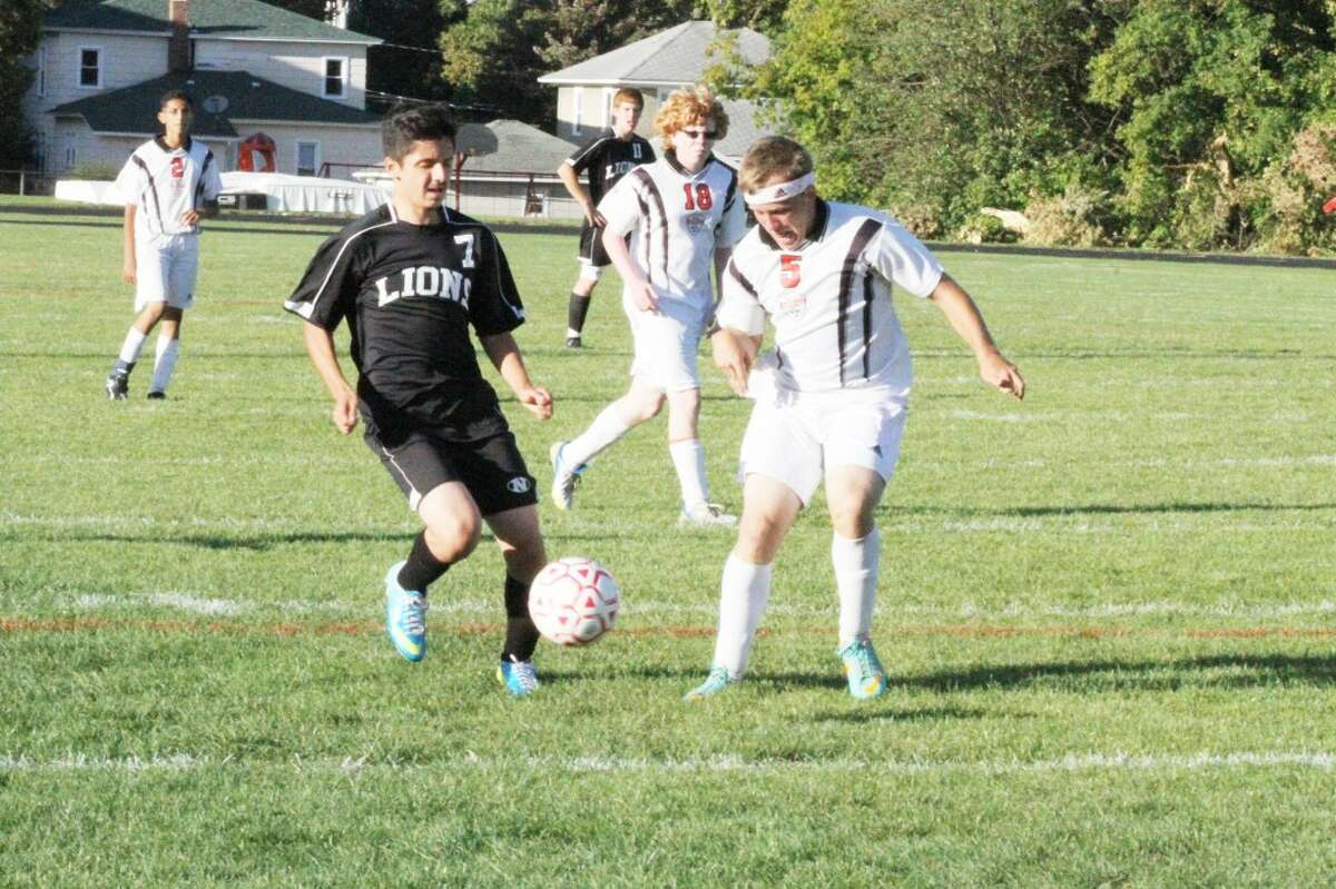 MATCH: Reed City soccer junior Dylan Langlois (5) plays the ball against Newaygo last week. (Herald Review photo/Martin Slagter)