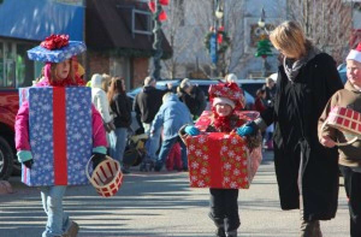 """PARADE: One of the highlights of the festival was the parade, which featured local businesses, organizations and more traveling down Upton Avenue. Kids and adults dressed up to the theme of """"Winter Wonderland."""""""