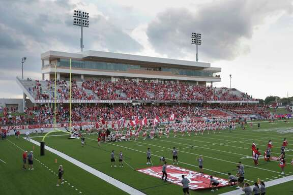 The Katy Tigers take the field during the high school football game between the North Shore Mustangs and the Katy Tigers at Legacy Stadium in Houston on Friday, Aug. 31, 2018.