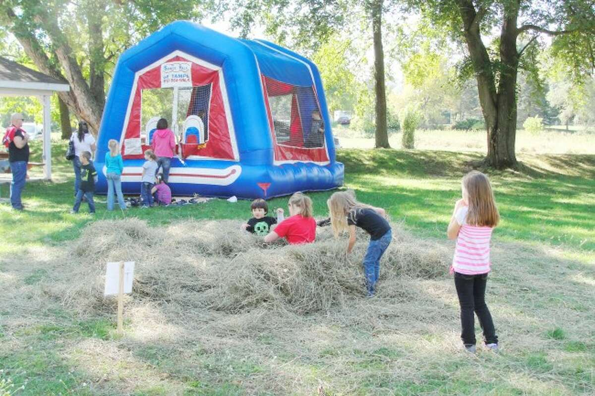FUN AND GAMES: During the event, kids games were set up throughout the park along with a bounce house for little ones to enjoy. Jeff Cibulka and his band entertained the crowd with music and free refreshments were provided as well.